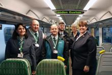 Platform and ticket office staff at London Euston handing over old uniforms to Captain Lorraine Kinnear, from The Salvation Army Chalk Farm branch and Lt Colonel Alison Burns, who worked across London for The Salvation Army before recently retiring.