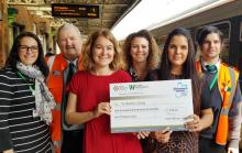 West Midlands Railway and London Northwestern Railway staff with Emma Bould from Alzheimer's Society (centre right), handing over the first cheque for cash left in lost property