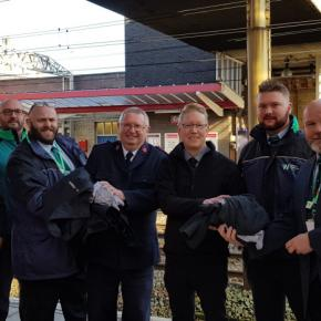 Revenue protection managers and senior conductors working on London Northwestern services to/from Liverpool and Crewe, passing over old uniforms to Major Steven Watson from the Crewe branch of The Salvation Army and Justin Frost from The Salvation Army Tr